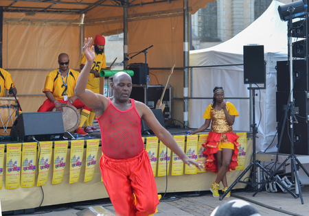 LE MANS, FRANCE - APRIL 22, 2017: Festival Europe jazz A man dances a Caribbean dance. Musicians dress with costumes and playing drums Caribbean music
