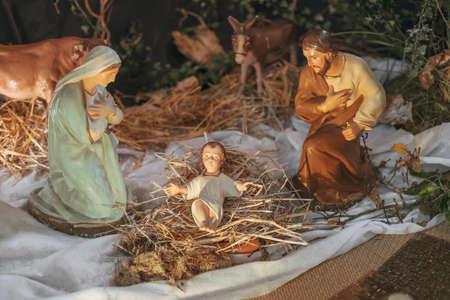 Photo pour Christmas creche with Joseph Mary and small Jesus in a crib - image libre de droit