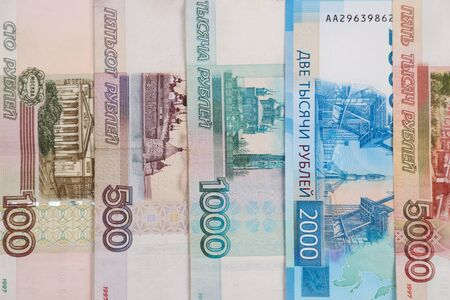 Photo pour Banknotes of Russian money in denominations of 100, 500, 1000, 2000, 5000 rubles, arranged vertically. - image libre de droit