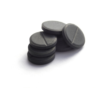 activated coal tablets isolated on white
