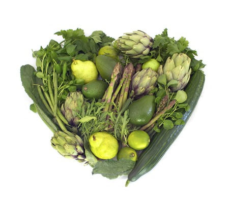Big heart made of green veggies isolated on whiteの写真素材
