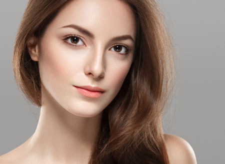 Photo for Young beautiful woman face portrait with healthy skin on gray background. Studio shot. - Royalty Free Image