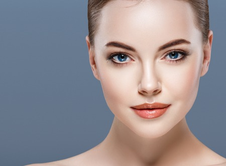 Photo for Woman beauty portrait skin care concept on blue background. Studio shot. - Royalty Free Image