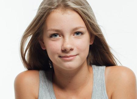 Cute teenage girl freckles woman face closeup portrait with healthy skin. Studio shot.