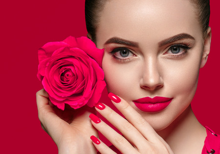 Photo pour Beauty woman with rose flower beautiful curly hair and lips. Studio shot. - image libre de droit