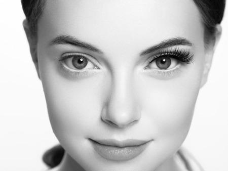 Foto de Eye lashes, lash extension woman  lashes close up macro monochrome. Studio shot. - Imagen libre de derechos