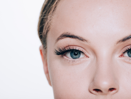Foto de Beautiful woman face with eyelashes lashes extension before and after beauty healthy skin natural makeup closed eyes. Studio shot. - Imagen libre de derechos