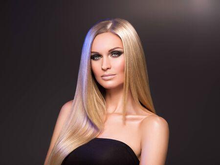 Foto de Hair beautiful long blond hairstyle woman fashion makeup healthy skin and hair black background. Studio shot. - Imagen libre de derechos