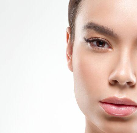 Foto de Asia beauty woman healthy skin face clean fresh skin spa. Studio shot. Isolated on white. - Imagen libre de derechos