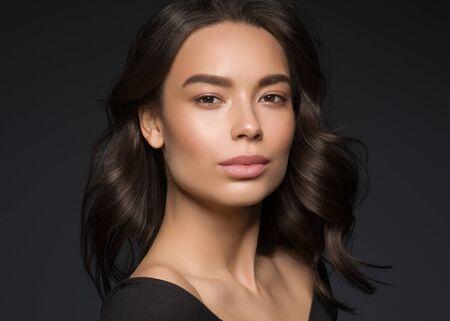 Photo pour Asian beauty female black background curly black hair natural make up. Studio shot. - image libre de droit