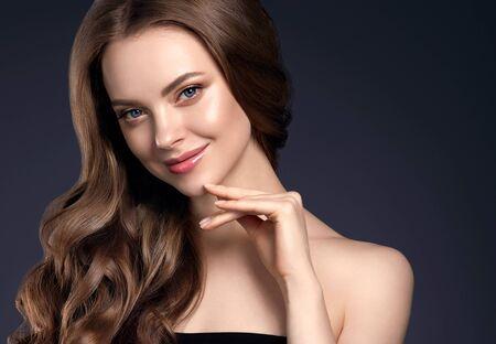 Photo pour Beauty hair woman curly hairstyle natural makeup. Studio shot. - image libre de droit