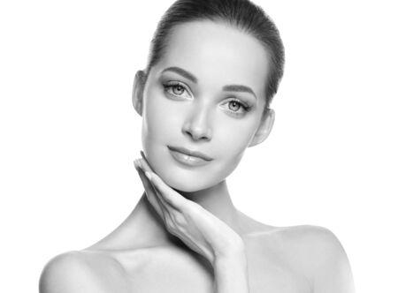 Photo pour Woman beauty face healthy skin natural makeup beautiful young model. Studio shot. Monochrome. Gray. Black and white. - image libre de droit