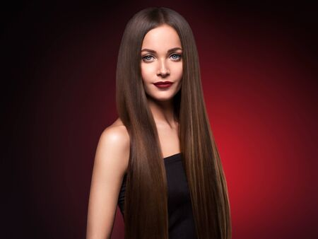 Photo pour Beautiful hair woman long smooth brunette hairstyle beauty healthy hair female model portrait.  Studio shot. - image libre de droit