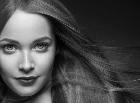 Foto de Beautiful hair woman long smooth brunette hairstyle beauty healthy hair female model portrait.  Studio shot. Monochrome. Gray. Black and white. - Imagen libre de derechos