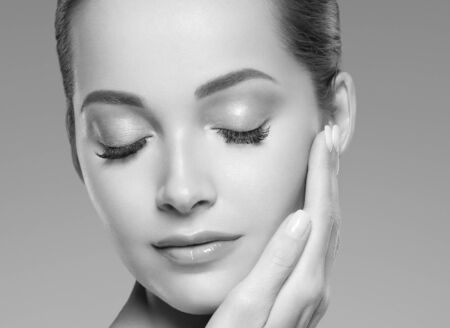Photo pour Skin care woman beauty face healthy face skin cosmetic model emotional andhappy. Studio shot.  Monochrome. Gray. Black and white. - image libre de droit