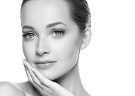 Foto de Woman beauty face healthy skin natural makeup beautiful young model. Studio shot. Monochrome. Gray. Black and white. - Imagen libre de derechos