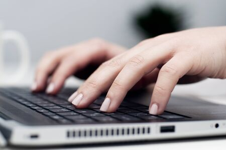 Photo for Closeup female hands typing on laptop keyboard. Young caucasian woman working on laptop, pressing keys. Work from home, stay at home, home office, remote work or telecommuting concept. - Royalty Free Image
