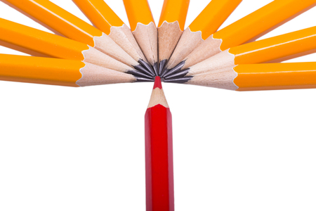 Red sharpened pencil among non sharpened yellow isolated