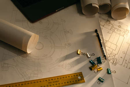Photo pour Engineering drawings and side light, protractor, notebook, term paper or thesis project. Applied mechanics - image libre de droit