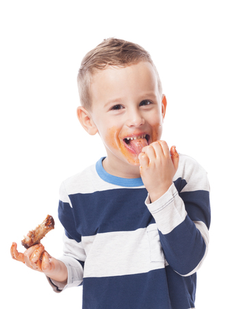 Photo pour Adorable kid eating bbq ribs on isolated white - image libre de droit