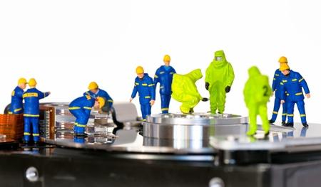 Team of technicians repair hard disk. Hard Drive repair concept