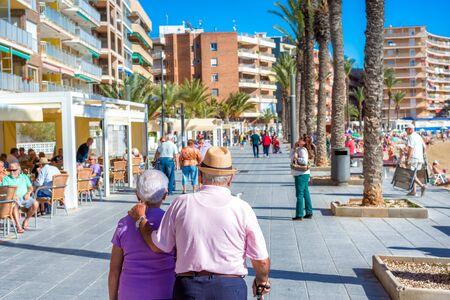 Photo for TORREVIEJA, SPAIN - NOVEMBER 13, 2017: A senior couple walking on the streets of Torrevieja. - Royalty Free Image