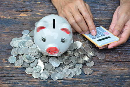piggy bank and stack coins for saving money and success, tax season
