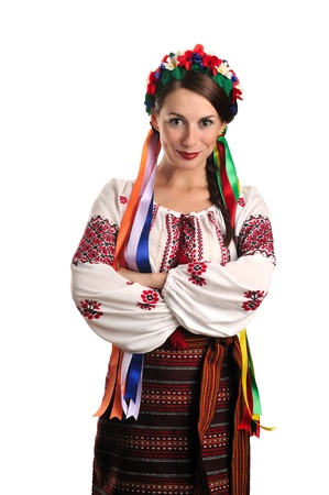 Portrait of joyful young Ukrainian woman in national costume. Isolated on white background