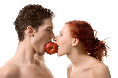 Photo pour Couple biting an apple, isolated on white - image libre de droit