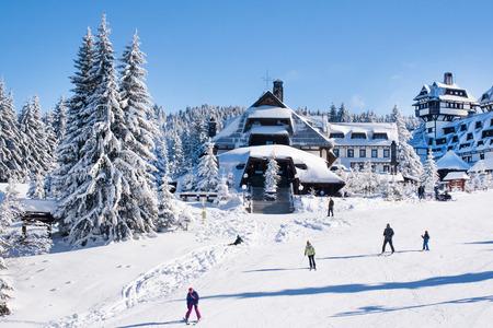 Kopaonik, Serbia - January 22, 2016: Panorama of ski resort Kopaonik, Serbia, ski slope, people, houses covered with snow