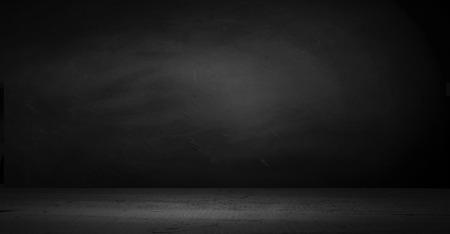 Foto de cement floor in dark room with spot light. black background. - Imagen libre de derechos