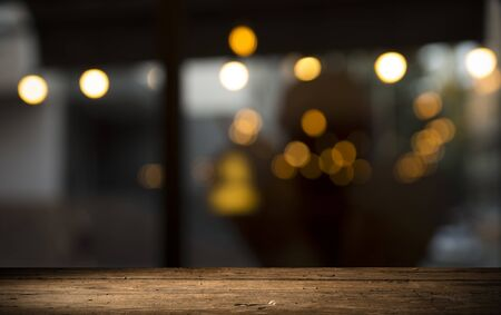 Photo for Empty wood table top on blur light gold bokeh of cafe restaurant in dark background - Royalty Free Image