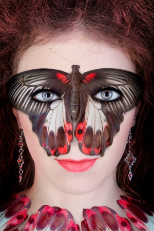 Beautiful lady in a butterfly mask