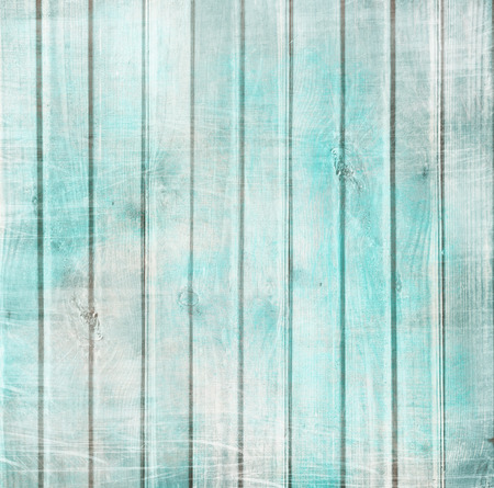 Rustic old plank background in turquoise, mint and beige colors with textured scratches and antique cracked paint for scrapbooking and decoupage