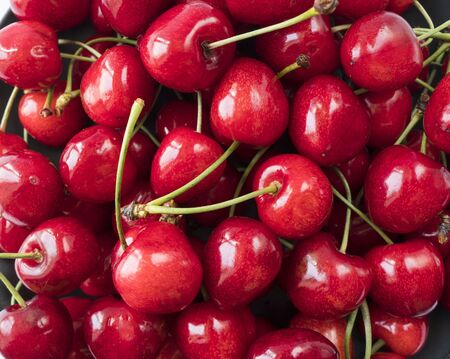 Photo pour Fresh red cherries. Texture cherries fruits close up. Cherry fruit. Cherries with copy space for text. Top view. Background of cherries. - image libre de droit
