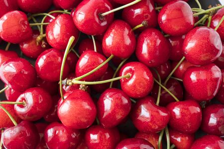 Photo for Fresh red cherries. Texture cherries fruits close up. Cherry fruit. Cherries with copy space for text. Top view. Background of cherries. - Royalty Free Image