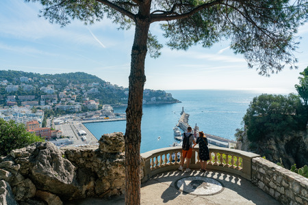 Nice, OCT 20: Aerial morning view of the famous Le Port with ships, building from Castle Hill on OCT 20, 2018 at Nice, France