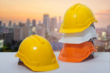 Photo pour Safety helmet stacked in the background is a business district. - image libre de droit