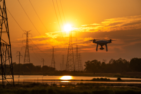 Foto de Drone surveying High voltage towers the sunset background - Imagen libre de derechos