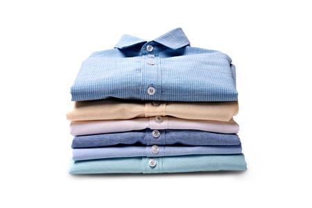 Photo pour Classic men's shirts stacked on white background - image libre de droit