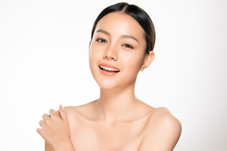 Foto de Beautiful Young asian Woman with Clean Fresh Skin look. Girl beauty face care. Facial treatment. Cosmetology, beauty and spa. - Imagen libre de derechos