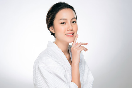 Photo pour Beautiful Young Woman with Clean Fresh Skin. Face care . Facial treatment . Cosmetology , beauty and spa. Asian women portrait - image libre de droit