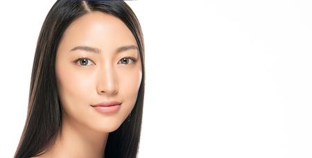Photo pour Beautiful Young Woman with Clean Fresh Skin. Face care . Facial treatment . Cosmetology , beauty and spa. Asian women portrait - image libre de droit