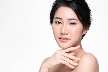 Photo for Beautiful Young Asian Woman with Clean Fresh Skin touch own face, Facial treatment, Cosmetology, beauty and spa, - Royalty Free Image