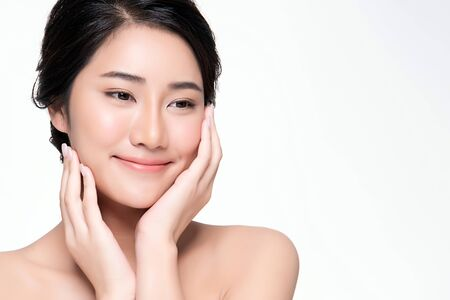 Photo pour Beautiful Young Asian Woman with Clean Fresh Skin touch own face - image libre de droit