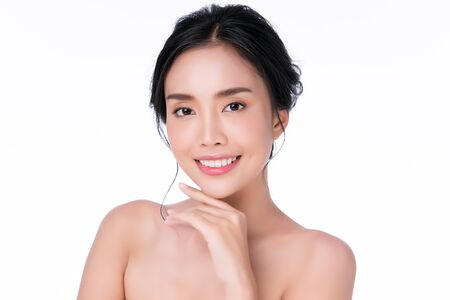 Photo for Beautiful young Asian woman touching soft cheek and smile with clean and fresh skin. Happiness and cheerful with, on white background, Beauty and Cosmetics Concept, - Royalty Free Image