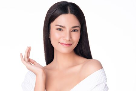 Foto de Beautiful Young Asian Woman with Clean Fresh Skin. Face care, Facial treatment, on white background, Beauty and Cosmetics Concept - Imagen libre de derechos