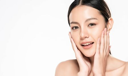 Photo pour Beautiful Young asian Woman touching her clean face with fresh Healthy Skin, isolated on white background, Beauty Cosmetics and Facial treatment Concept. - image libre de droit