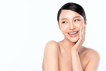 Foto de Beautiful Young asian Woman touching her clean face with fresh Healthy Skin, isolated on white background, Beauty Cosmetics and Facial treatment Concept, - Imagen libre de derechos