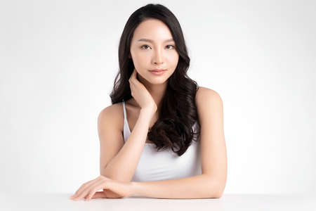 Photo pour Beautiful Young asian Woman with Clean Fresh Skin, on white background, Face care, Facial treatment. Cosmetology, beauty and spa. Asian women portrait - image libre de droit